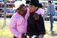 A bull rider is greeted after a successful ride.