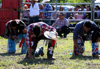 The riders say a prayer before the start of bull riding.