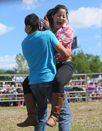 One of the games played before the rodeo was for women to run100 feet into the arms of several different men.