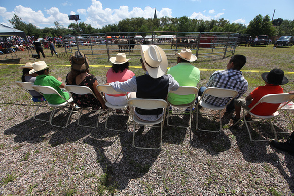 Family and friends pulled up chairs to get a front row seat to watch the bull riding.