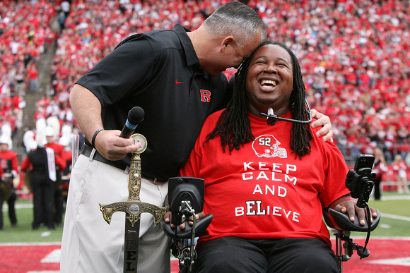 Rugters head coach Kyle Flood hugs Eric Legrand as Legrand's number was retired. Piscataway, NJ
