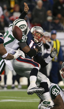 Calvin Pace of the NY Jets sacks Tom Brady of the New England Patriots, causing a fumble in the AFC Divisional Game.  Foxboro, Massachusetts