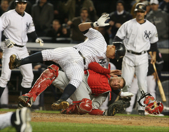 Yankees Alex Rodriguez is tagged out at home by Angel catcher Jeff Mathis in the fifth inning during Game 1 of the American League Championship Series.  Bronx, NY